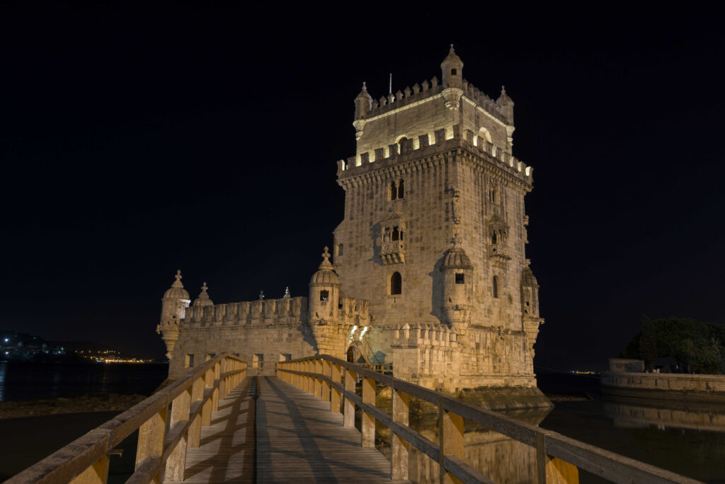 Lisbon, Portugal at Belem Tower on the Tagus River by night