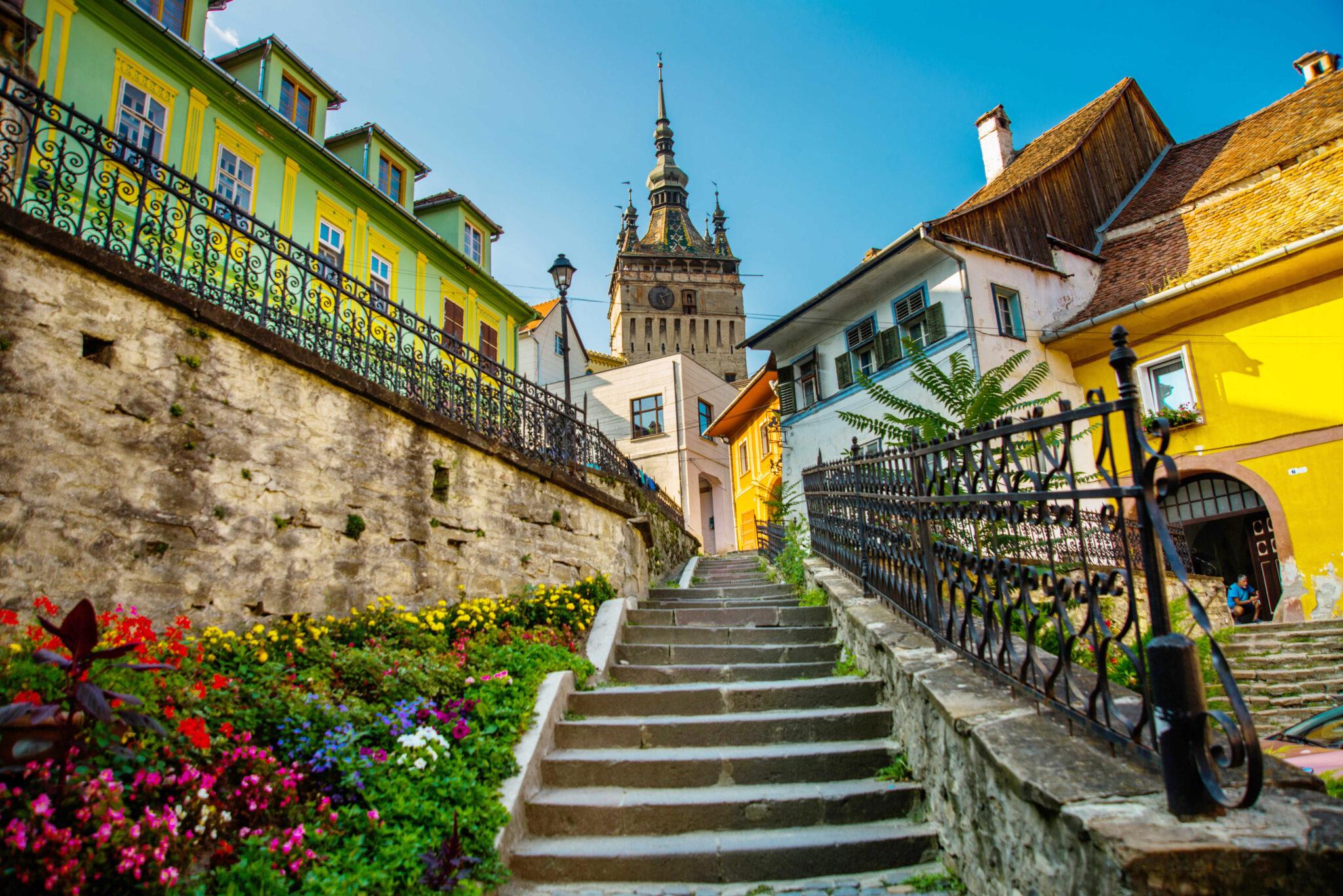 SIGHISOARA, TRANSYLVANIA, ROMANIA - AUGUST 2019: Old building in Sighisoara citadel. Tower Clock in Sighisoara. Turnul cu ceas