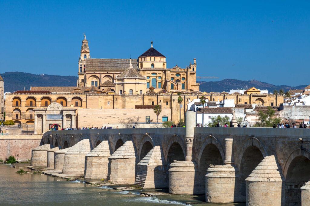 Cityscape of Cordoba with roman bridge and Mezquita, Andalusia, Spain