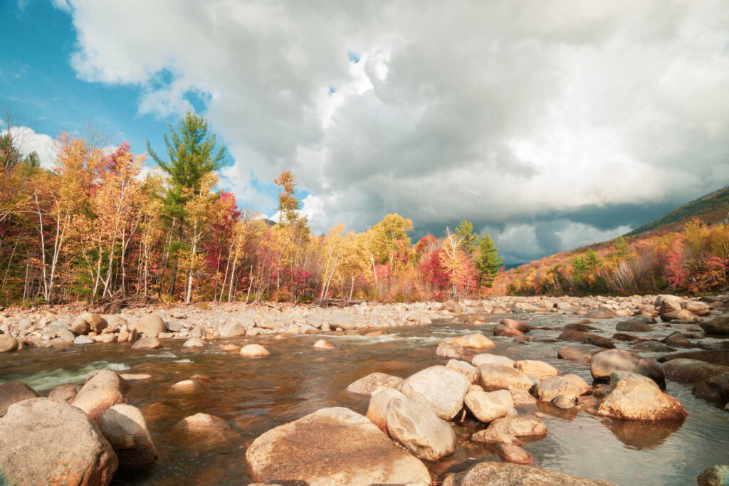 The Best New England Towns in Fall to Visit - autumn at the base of Loom Mountain in Lincoln New Hampshire